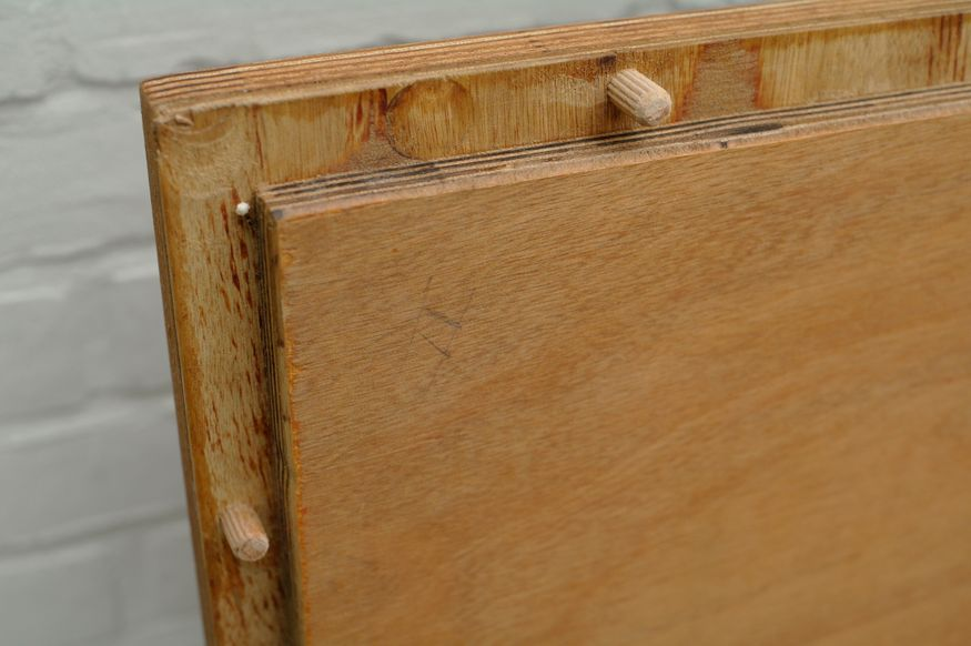 The table top with dowels on the bottom side